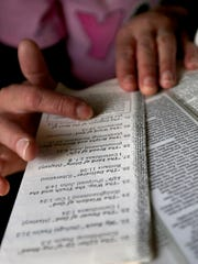Karen Marx  reads a list of daily biblical quotes at her home on October 27, 2014 in New London, Wis. Karen's husband Adam Marx has been charged with bigamy in Vernon County. Wm. Glasheen/Post-Crescent Media