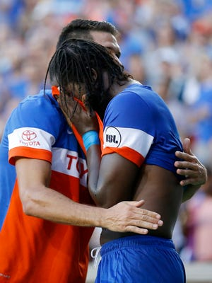 FC Cincinnati's Danni Konig (11) and Djiby Fall (9) celebrate Fall's go-ahead goal in the second half of the US Open Cup soccer match between FC Cincinnati and Columbus Crew at at Nippert Stadium on June 14, 2017.