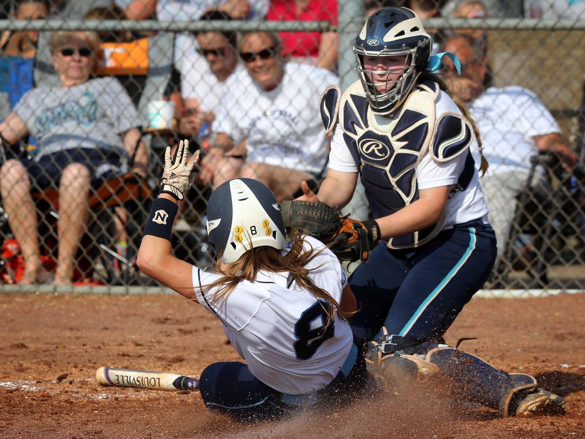 Siegel's Kara Lynee Levi tags out harding Valley Academy's Leslie Beecham at home in the fourth inning Tuesday during the first round of the Class AAA Softball Tournament.