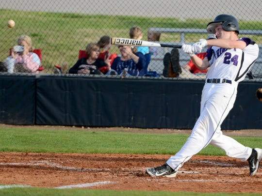 Trinity Christian Academy's George Tatum makes a hit during Tuesday night's game against Adamsville.