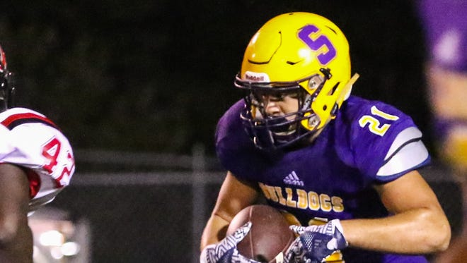 Smyrna's Blake Watkins carries the ball against Overton on Friday night.