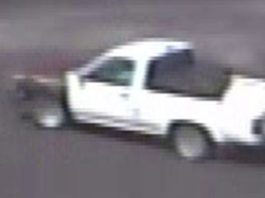 Washoe County Sheriff's deputies obtained a security photo of a mid-1990's Toyota truck they believe a man, who is wanted in a stolen credit card and vehicle case, used to leave a Reno Walmart store late last month. The man allegedly used the stolen card to make purchases at the store.