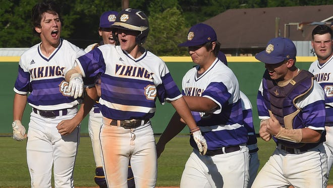 The Opelousas Catholic Vikings celebrate their win over Episcopal Friday in the Quarterfinal baseball playoff game at Gene Mills Memorial Field.