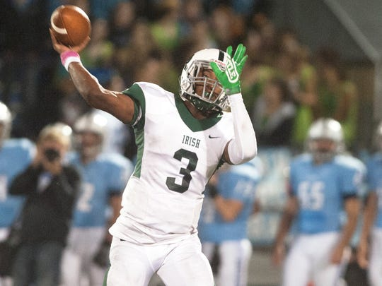 Camden Catholic's quarterback Rob Mccoy Jr. throws a pass during the 1st quarter of Friday night's football game between Camden Catholic and Shawnee played at Shawnee High School.  10.13.17