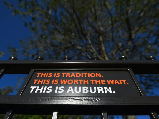 A sign on the fence surrounding the Toomer's Corner