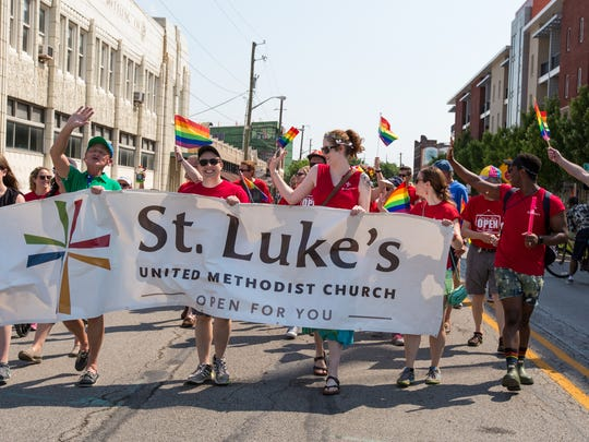 St. Luke's United Methodist Church marches in the Indy Pride Parade in downtown Indianapolis on Saturday, June 9, 2018. The parade route began at College and Mass. Ave. and headed west toward Historic Military Park.