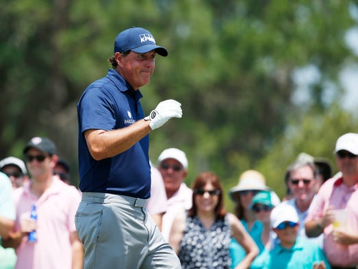 Phil Mickelson walks to the 3rd tee during the second