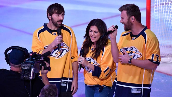 Lady Antebellum sings the National Anthem before game 6 of the second round NHL Stanley Cup Playoffs at the Bridgestone Arena  Sunday, May 7, 2017, in Nashville, Tenn.