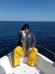 Brian Lindner with a keeper striped bass from Barnegat