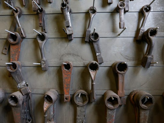 Wrenches hang on a board at the James River Power Station.