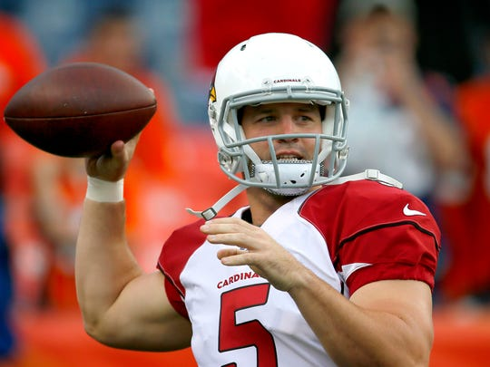 Cardinals quarterback Drew Stanton warms up prior to an NFL preseason game against the Broncos on Sept. 3, 2015 in Denver.
