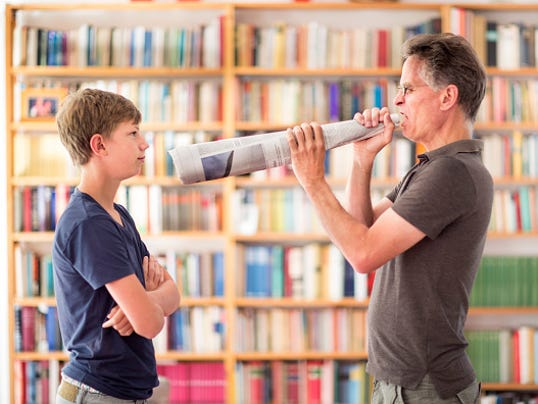 Father Yelling Trough A Megaphone