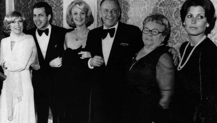 Actor Frank Sinatra, center, poses with his family