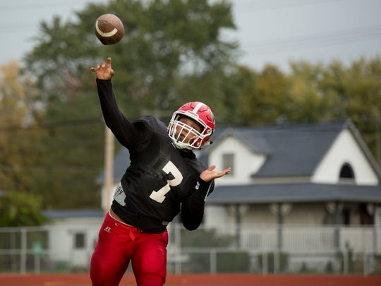 Port Huron's DeAngielo Sanderson Jr. throws a pass during practice Tuesday, October 20, 2015 at Port Huron High School.