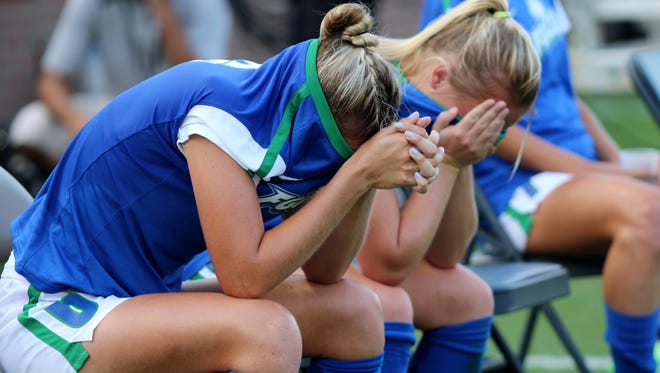 FGCU seniors Shea Rhoney (left) and Emma Blackwell bury their heads following the 2-0 loss to No. 18 Duke in the second round of the NCAA tournament in Gainesville Friday night.