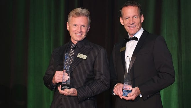 Steve Marino, left, and Gary Aubuchon were inducted Tuesday into the Junior Achievement of Southwest Florida Business Hall of Fame, Lee County.