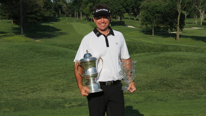 Paramount head pro Steve Scott poses with the hardware after winning his first Met PGA event.