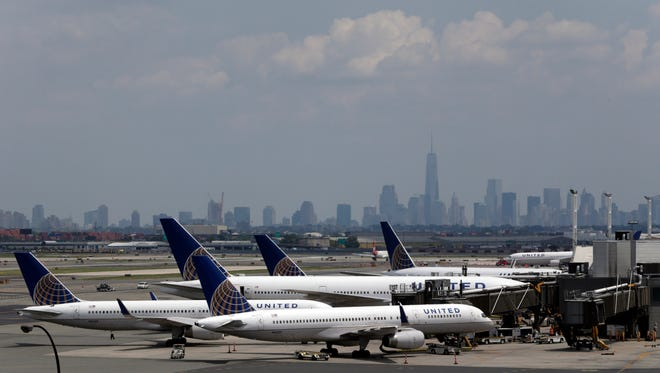 United Airlines jets are seen at the gate at Newark Liberty International Airport, Tuesday, July 22, 2014, in Newark, N.J. In a sign of increased caution about flying near combat zones, U.S. and European airlines halted flights to Israel Tuesday after a rocket landed near Tel Aviv's Ben Gurion Airport.