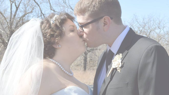 Melanie and Paul share a kiss at their wedding.