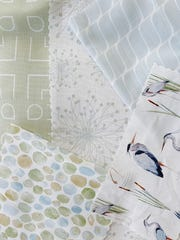 Resort at Home's Vero Beach line exudes a tranquil vibe so the fabrics are muted pastels with seaglass, sargassum and heron designs.