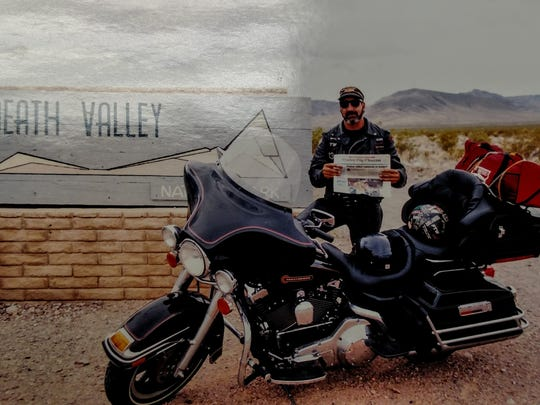 Jeff Dold poses with a copy of the Garden City Observer in 1999 near Death Valley in California.