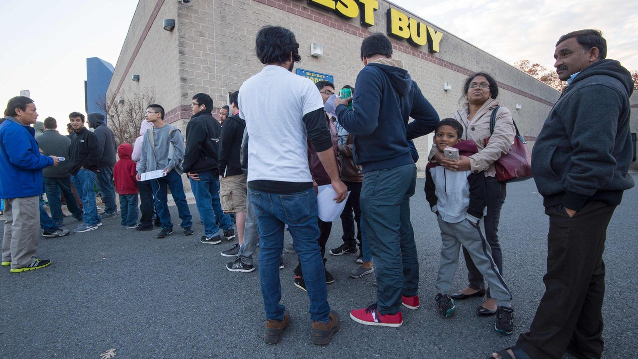 Black Friday shoppers rush into stores