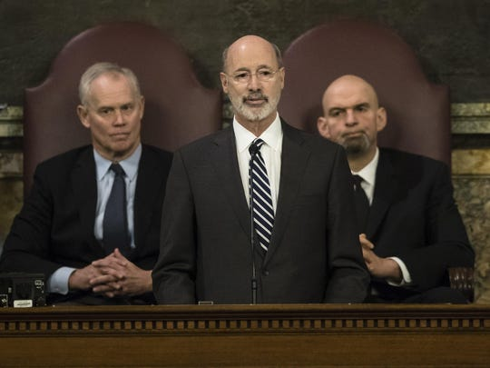 Democratic Gov. Tom Wolf delivers his budget address for the 2019-20 fiscal year to a joint session of the Pennsylvania House and Senate in Harrisburg, Pa., Tuesday, Feb. 5, 2019. House Speaker Mike Turzai, R-Allegheny, and Lt. Gov. John Fetterman is at right. (AP Photo/Matt Rourke)