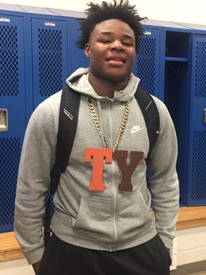 """Mansfield Senior's Da'Quan Hilory shows off the """"hustle chain"""" he was awarded for his play in weekend wins over Mount Vernon and Ontario."""
