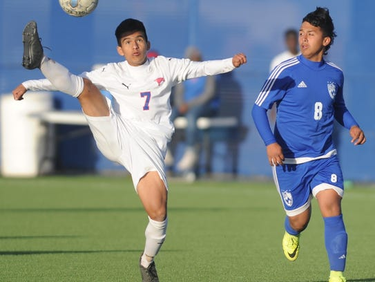 Cooper's Hector Tijerina (7) plays the ball while Amarillo