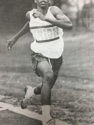 Union County's Jonathan Brown raced down the track in a meet in April 1997. Brown won the long jump competition in the meet by jumping 20-5 feet.