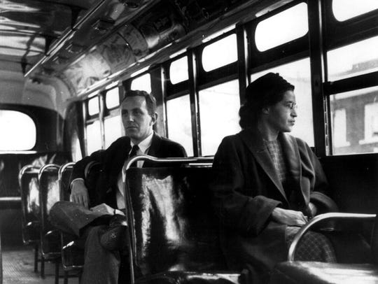 Rosa Parks sits in the front of a city bus, December 21, 1955, as a Supreme Court ruling which banned segretation on Montgomery, Alabama's public transit vehicles took effect.