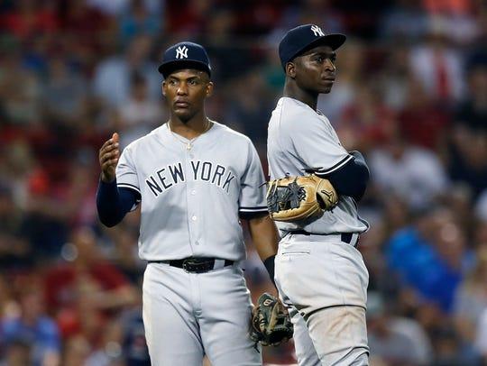 New York Yankees' Miguel Andujar, left, Didi Gregorius