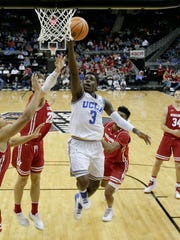 UCLA's Aaron Holiday beats the defense to the basket.