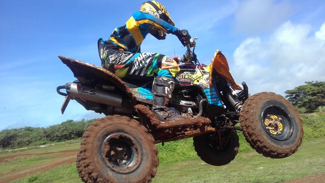 In this file photo, Mike Taimanglo rides a Yamaha third in the Open ATV division in a Monster Energy Guam Motocross Championship race.