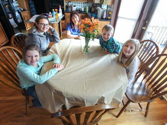 From left, Emma Carl, 7, Kennedy Carl, 15, Kendra Blair,