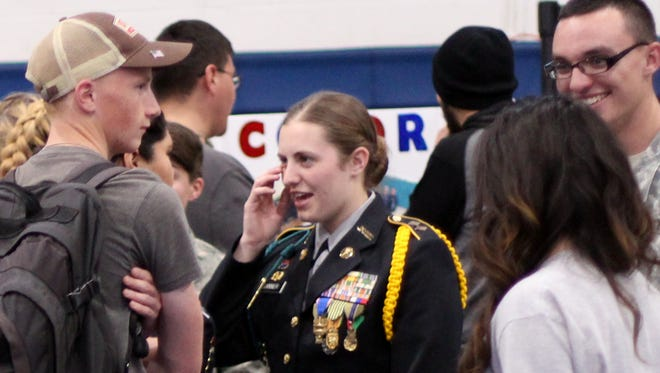 Deming High students gathered around the JROTC booth during the school's Career Technical Education Expo held Wednesday in the main gym.