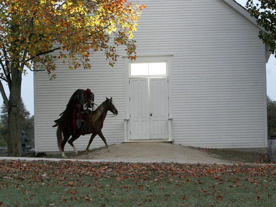 The Headless Horseman rides during the annual festvial at Conner Prairie.
