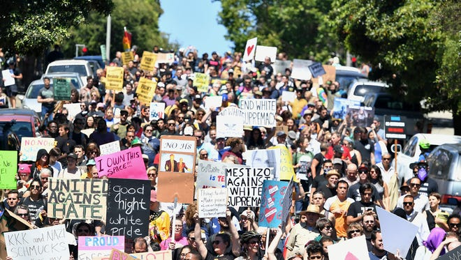 Protesters march in San Francisco, Saturday, Aug. 26, 2017. Officials took steps to prevent violence ahead of a planned news conference by a right-wing group.
