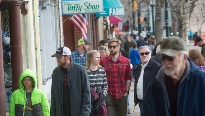 People wander the row of shops on Elkhorn Avenue in Estes Park on Black Friday.