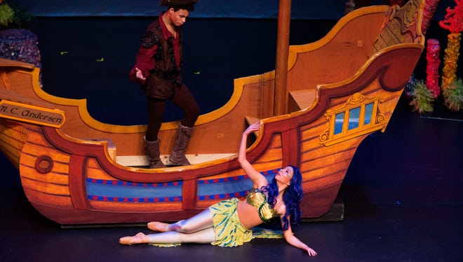 "Cameron Patton (as Prince Maris) and Amanda Roe (as Lorelei, The Littlest Mermaid) meet for the first time in ""The Littlest Mermaid,"" an adaptation of Hans Christian Anderson's story during a performance at the Preston Fine Arts Center Friday morning. The ballet is a production of the Children's Center for Dance Education."