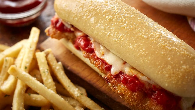 Olive Garden's new chicken parmigiana breadstick sandwich. The addition of breadstick sandwiches are just the latest attempt to revamp Olive Garden's menu and marketing as sales have declined for the past three of its fiscal years.
