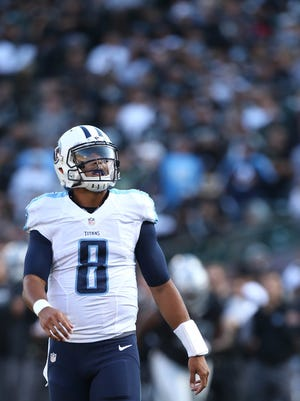 Tennessee Titans quarterback Marcus Mariota (8) looks towards the scoreboard during a break in the action against the Oakland Raiders in the second quarter at Oakland Alameda Coliseum.