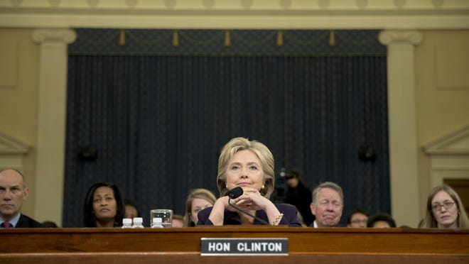 Democratic presidential candidate, former Secretary of State Hillary Rodham Clinton pauses as she testifies on Capitol Hill in Washington, Thursday before the House Benghazi Committee.