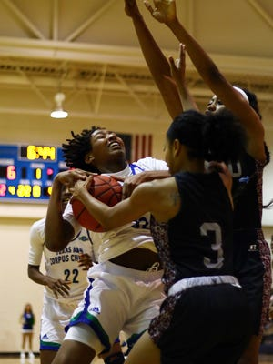 Erick Sifuentes / Special to The Caller-Times Texas Southern's Joyce Kennerson (3) forces a jump ball with Texas A&M-CC's Dalesia Booth during their game at the Dugan Wellness Center on Wednesday, Nov. 16, 2016.