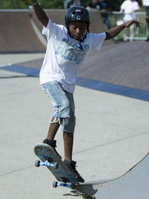 Skateboarders (clockwise from top) Jamal Lewis, 10, Michael Gage, Zach Neely, 12, and Julian Caro, 6, skate Saturday at a park built in front of the Indiana State Museum. The park was installed to teach new skaters about the physics of the sport through demonstrations.