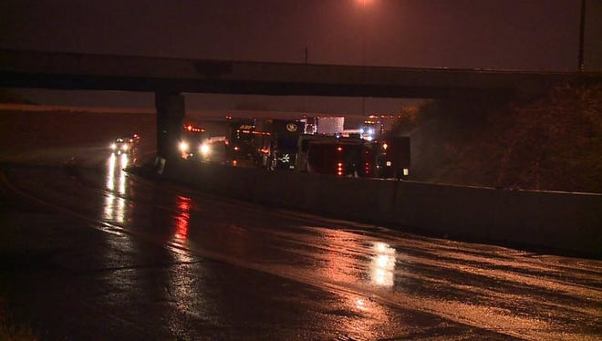 An overturned semi spilled fruit across the ramp on westbound Interstate 70 at the I-65 split.