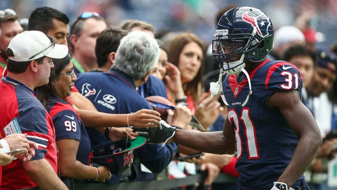 Houston Texans defensive back Charles James (31) shakes hands with fans before a game against the San Diego Chargers at NRG Stadium.