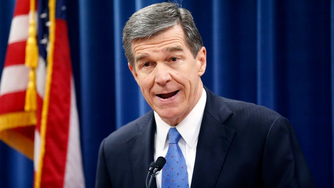 Roy Cooper holds a press conference to criticize efforts by Republicans to cut the power of the governor's office during the special session of the General Assembly on Dec. 15, 2016, in Raleigh, N.C.