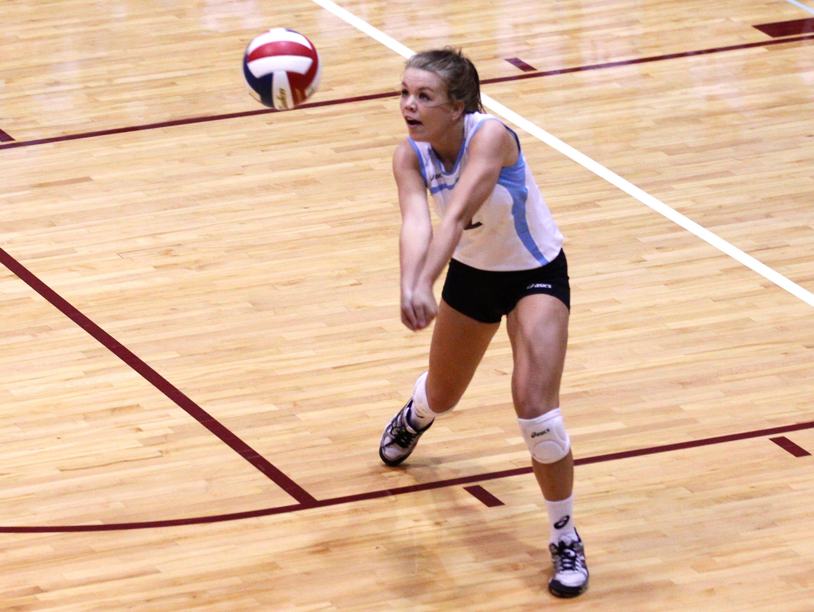 Assumption High School's McKenzie Watson (2) makes the play against Mercy Academy during their volleyball matches at Assumption High School in Louisville, Kentucky. September 8, 2014