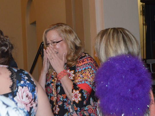 Ben Milam second-grade teacher Michelle Keller reacts after being named the Wichita Falls ISD's Elementary Teacher of the Year April 6 at the Forum.